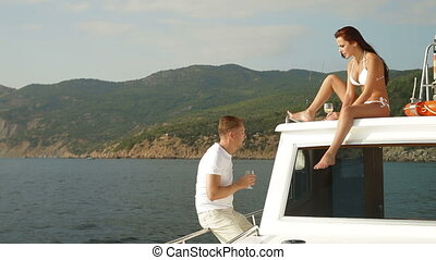 Couple Enjoying The Cruise on Yacht