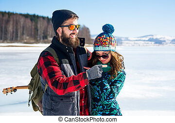 Couple enjoying the day on a frozen lake