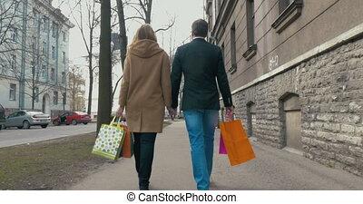 Couple enjoying the walk after good shopping