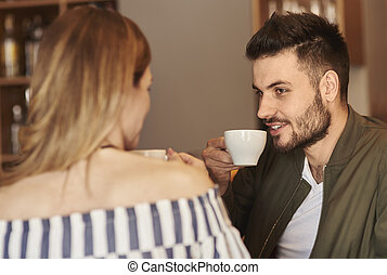Couple enjoying time with cup of coffee