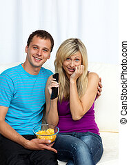 Couple enjoying watching a film
