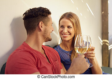Couple enjoying wine in their backyard