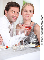 couple enjoying wine with dinner