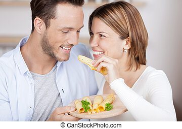 Couple enjoys a bite of cheese - Couple eats some cheese ...