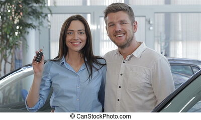 Couple enjoys the buying of car at the dealership - Lovely...