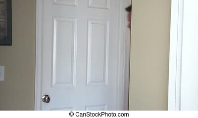 Couple Evesdropping Against Door