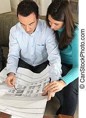 Couple examining a blueprint