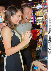 couple excited with the slot machine result