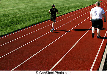 Couple exercising - 2 people on a racetrack