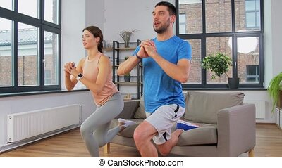 couple exercising and doing lunge at home - sport, fitness, ...