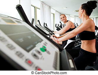 Couple exercising veloargometar