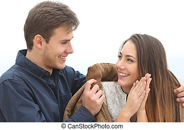 Couple falling in love with he covering her with his jacket