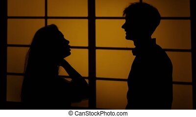 Couple fighting at home. Relations with quarrels. Silhouette. Close up