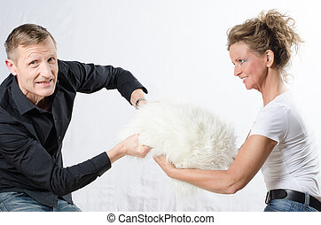 couple fighting for pillow
