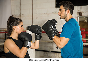 Couple fighting in a boxing ring