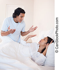 Couple fighting in the bedroom - Young couple fighting in...