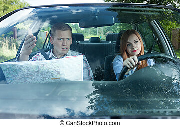 Couple fighting over driving directions - Young man and...