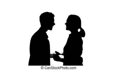 Isolated silhouette of a couple arguing