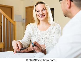 Couple filling in documents at home