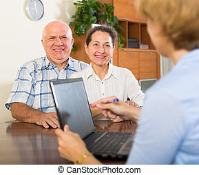 couple filling questionnaire for employee