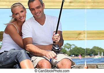 Couple fishing in the sun