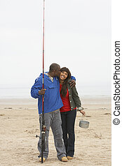 Couple Fishing On Beach
