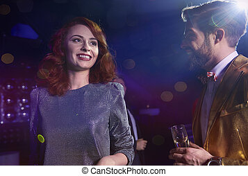 Couple flirting at new year's party