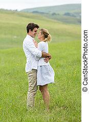 couple flirting on countryside