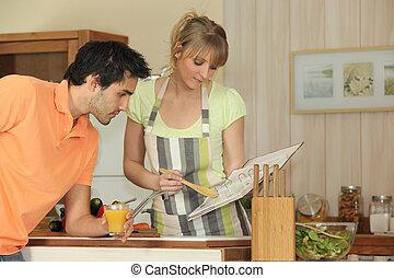 Couple following a recipe