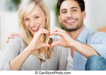 Couple Forming Heart Shape With Hands - Portrait of loving ...