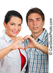 Couple forming heart with their hands