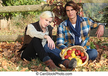 couple gathering apples