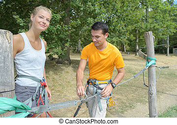couple getting ready for the rope park