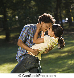 Couple getting romantic. - Man holding woman and dipping her...