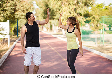Couple giving each other a high five