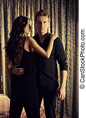 couple glamorous - Beautiful couple in love in bedroom. ...
