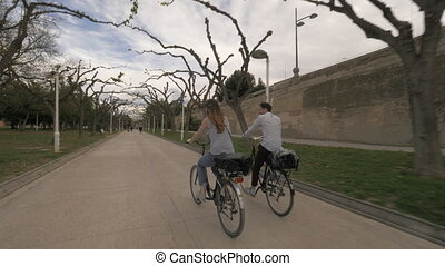 Couple going cycling in the park