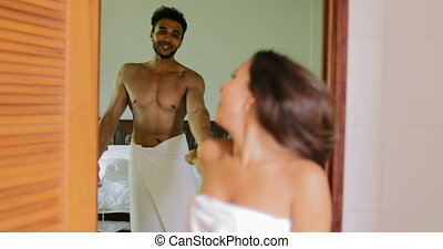 Couple Going To Bathroom Talking, Young Man And Woman In...