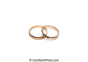 Couple golden wedding ring, one with diamond.