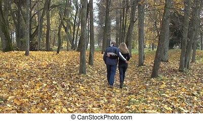 couple hand autumn path
