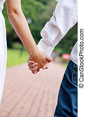couple hand in hand