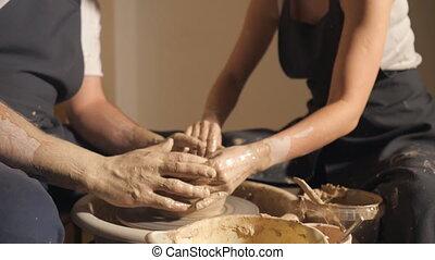 couple hands making clay jug, 4k