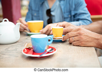 couple hands on table with cup of coffee espresso