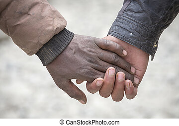 Couple hands on the street in India, close up.