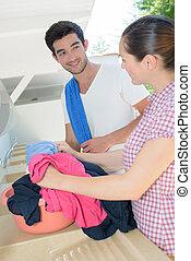 Couple handwashing clothes