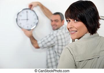Couple hanging clock