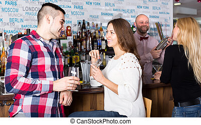Couple hanging out in bar