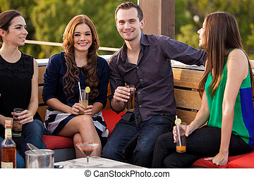 Couple hanging out with friends