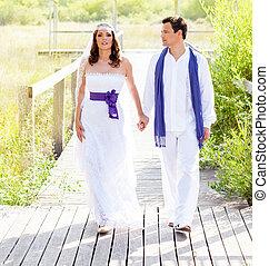 Couple happy in wedding day walking outdoor