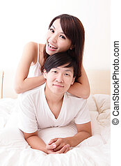 couple happy smile in bed